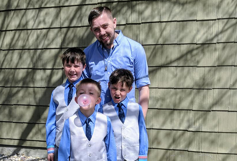 Photo of Parker Stewart with his three sons